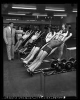 Vic Tanny with four women exercising at his gym Vic Tanny's Gym in Los Angeles, Calif., circa 1953