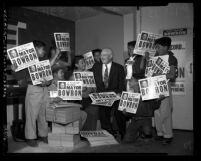 "Fletcher Bowron with group of Latino boys holding up campaign signs reading ""Re-Elect Mayor Bowron"" in Los Angeles, 1953"