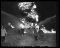 Firemen battling fire at Shell Oil distribution center at 2015 Long Beach Ave in Los Angeles, Calif., 1953