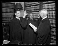 Thomas L. Griffith Jr. being sworn in by judges Victor Hansen and Eugene Fay, Los Angeles, Calif., 1953