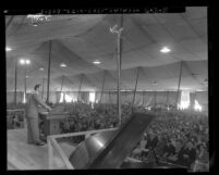 Evangelist Jack Shuler preaching at tent revival called Christ for Greater Los Angeles, Calif., 1953
