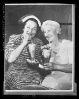 Copy of photograph Giuseppina Picchi Capurro and Mrs. Amerigo [Mary Catherine] Bozzani sipping ice cream floats in Los Angeles, Calif., 1953