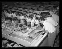 Claremont College students visiting fruit packing house in Los Angeles County, Calif., 1953