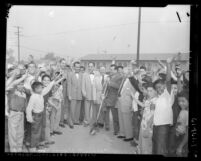 Six civic leaders and boys at groundbreaking ceremony for Eastside Boys' Club in Los Angeles, Calif., 1953