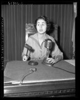Los Angeles City Councilwoman Rosalind Wiener [Wyman] at council table, Calif., circa 1953