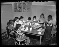 Children eating Thanksgiving dinner at Salvation Army Day Nursery School in Los Angeles, Calif., 1953