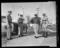 California Highway Patrolmen giving driver sobriety test in Los Angeles, Calif., circa 1953
