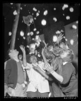 Michigan State students celebrating on float at Tournament of Roses Parade in Pasadena, 1954