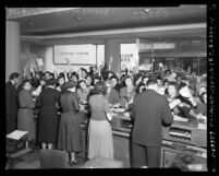 Western Union telegram office filled with League of Women Voters sending telegrams opposing Bricker Amendment, Los Angeles, 1954
