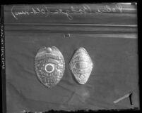 Close up of old and new Los Angeles Police badges side by side, circa 1927