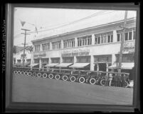 New Los Angeles police cars lined up in front of Albertson Motor Company building, circa 1925