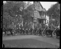 Los Angeles motorcycle police standing at attention during inspection by Police Chief Heath, circa 1924