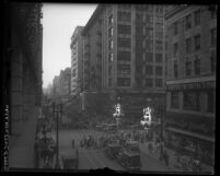 Cityscape of pedestrians, car traffic and buildings on fifth street, downtown Los Angeles, Calif. circa 1920
