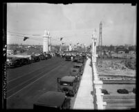 People and automobiles on Fourth St. Bridge during bridge's opening ceremony in 1931, Los Angeles, Calif.