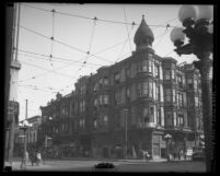 Buildings and pedestrians along southeast corner of Spring and First Streets known as the Wilson Block, Los Angeles, 1920