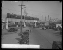 Los Angeles, Calif. Pacific Electric Red Car passing over Pico Street viaduct with people and autos below, circa 1927