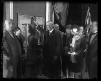 Mayor George Cryer flipping the switch to initiate new Wilshire Blvd. lighting system in Los Angeles, Calif., 1928