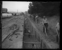 Water and Power Department workers digging a trench for pipeline in Los Angeles, Calif., circa 1920