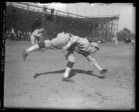 Baseball player Bill McCabe fielding a ground ball