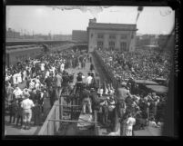 Crowd at train station waiting for Aimee Semple McPherson's arrival from Douglas, Arizona