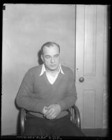 "Los Angeles police detective Edward ""Eddie"" P. Nolan sitting in chair, charged with murder, circa 1931"