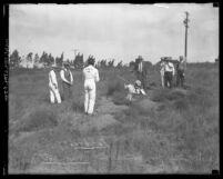 Prisoners digging for bones on Northcott Chicken Ranch in Riverside County, 1928-1929