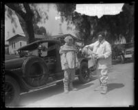 Two oil well fire fighters in their asbestos suits at Santa Fe Springs, Calif. oil wells fire in 1928