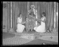 Man dressed as Aztec Emperor Montezuma with two women flanking him at 1931 Valencia Orange Show