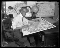 Los Angeles Times Illustrator Charles Owens at his desk working, circa 1920