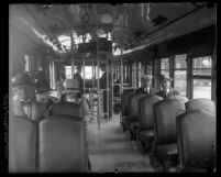 Interior of a Pacific Electric street car with passengers seated in Los Angeles, Calif., circa 1920