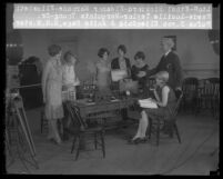 Anita Page, Rufus B. Von KleinSmid, and 5 women being filmed as they experiment with a telegraphone, circa 1928