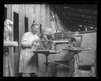 Sculptor Robert Paine working in his studio in Los Angeles, Calif., circa 1935