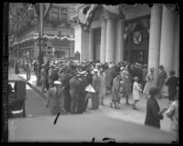 Depositors standing outside the Pan American Bank doors the day of its closing