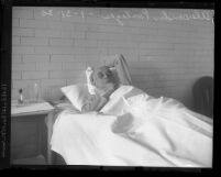 Theatrical entrepreneur Alexander Pantages lying in a jail hospital bed in Los Angeles, Calif., 1930