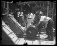 Wine barrel being returned by police to Tony Pazich's cellar during Prohibition in 1929, Los Angeles, Calif.