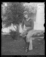 Aviatrix Peggy Paxson sitting in her aviator's outfit, Calif., circa 1929