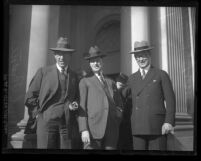 Paul Payne standing with E.W. Sinclair and J.J. McGraw at Los Angeles, Calif. oil convention in 1926