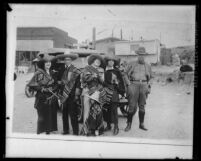 Jacob C. Denton with group of people dressed in Mexican sombreros and sarapes, circa 1920