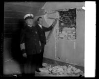 Los Angeles police officer Ray Cottle and Captain Clem Peoples revealing old jail cell door in 1929