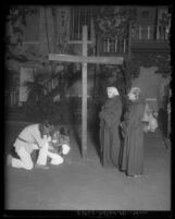 "Scene Three from ""First Californians"" pageant showing Indians kneeling at a cross, 1929"