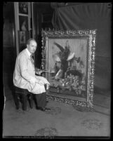 Artist and restorer Alver Regli sitting in front of a painting he's restoring in Los Angeles, Calif., 1931