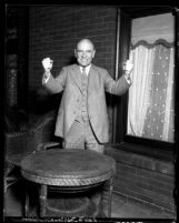 Mark Requa, Republican National Committee man of California, with his fists raised, circa 1930