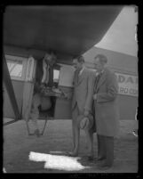 Pilot Paul E. Richter Jr. in 1928 handing over first piece of freight ever delivered by air Los Angeles, Calif. from Europe