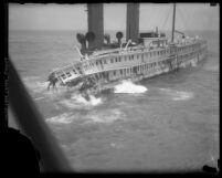 Angled side view of sinking steamship S. S. Harvard on Point Arguello, Calif., 1931