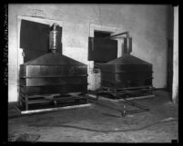 Two large liquor stills side by side, Los Angeles, Calif., circa 1920