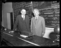 Richard C. Tolman and Albert Einstein standing in front of blackboard at California Institute of Technology in 1932
