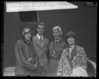 Madonna Turner, Howard Hughes, Capt. Roscoe Turner and Greta Nissen standing beside plane in Los Angeles, Calif., circa 1928