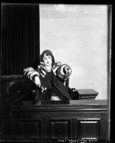 Thelma Ungeheuer on witness stand pointing out her alleged attacker during trial in Los Angeles, Calif., 1931