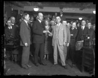 Rex B. Goodcell handing a ring to new Los Angeles, Calif. Internal Revenue collector, Galen H. Welch in 1926
