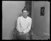 Carl Westcott in front of a jail cell in Los Angeles, Calif., 1927